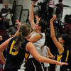 Newburyport: Newburyport's Molly Rowe shoots for two past Lynnfield defenders last night. Bryan Eaton/Staff Photo