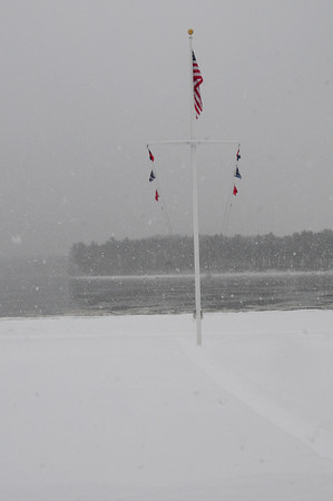Amesbury: Visibillity was low at one point during yesterday's storm, but the winds weren't as strong as last week's storm evidenced by this flag pole on Amesbury's Point Shore along the Merrimack River. Bryan Eaton/Staff Photo