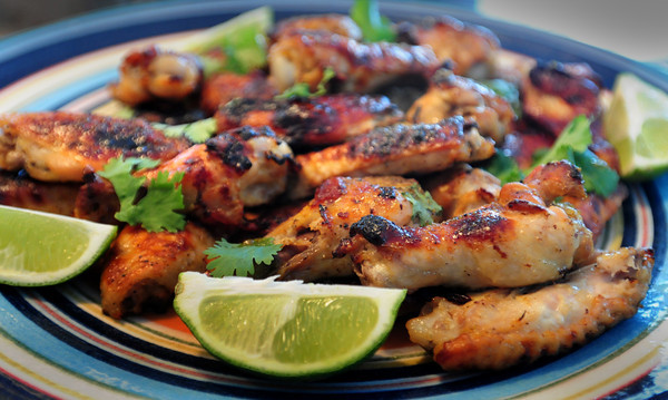 Rowley: Tequila and Lime Chicken Drumsticks garnished with cilantro. Bryan Eaton/Staff Photo