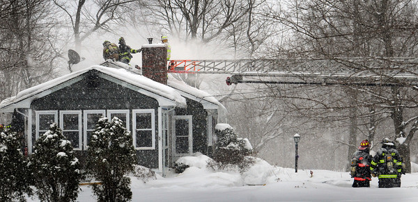 Amesbury: Amesbury firefighters vent a fire in a single-family home at 6 Pond Hill Road late yesterday morning. Nobody was home at the time of the blaze which was contained quickly. Bryan Eaton/Staff Photo