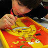 Salisbury: Justin Mulcahy, 9, of Salisbury plays a game of Operation, The Simpson's Edition, during board game time at the Boys and Girls Club on Tuesday afternoon. Only about a quarter of the normal participants were there and the club was likely to be closed Wednesday due to storm number two. Bryan Eaton/Staff Photo