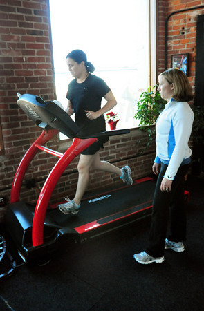 Newburyport: Sarah White works on the treadmill at Natural High with co-owner and trainor Kim Marttila. Bryan Eaton/Staff Photo