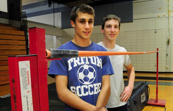 Byfield: Triton high jumpers Adam Jones, left, and Jake Stelline. Bryan Eaton/Staff Photo