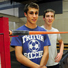 Byfield: Triton high jumpers Adam Jones, left, and Jake Stelline. Bryan Eaton/Staff Photo