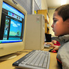 Salisbury: Kaden Hawkins plays a game of Raft Wars in the computer room keeping dry from the storm at the Boys and Girls Club on Tuesday. The six year-old is from Salisbury. Bryan Eaton/Staff Photo