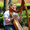 Newburyport: David Bishop of Newburyport plays his harp along Inn Street Tuesday morning, as the nice weather brought crowds to Newburyport's downtown. Photo by Ben Laing/Staff Photo