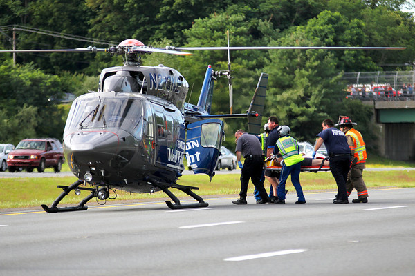 Byfield: A passenger from a pick up truck that rolled over on Rt. 95 near Exit 55 in Byfield Wednesday afternoon is loaded into a helicopter and taken to a Boston hospital. Photo by Ben Laing/Staff Photo