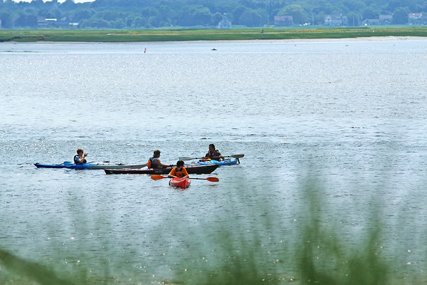 Newburyport: A group of kayakers paddle off the beach at Plum Island Point Monday afternoon. Photo by Ben Laing/Staff Photo