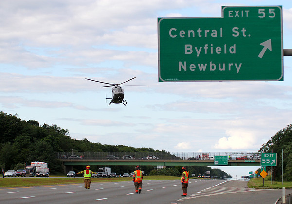 Byfield: A Medflight helicopter lands in the northbound lane of Rt. 95 Wednesday, after a pick up truck rolled over, injuring two passengers. Photo by Ben Laing/Staff Photo