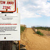Newburyport: Beach access at the end of 53rd Street on Plum Island has been re-opened, although a sign still remains that warns of its closure. Photo by Ben Laing/Staff Photo