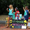 Newburyport: Caroline Kolesha, left, Shae Gallagher, middle, and her sister Isabel, sell lemonade and popcicles to passer-bys on High Street in Newburyport Monday  afternoon. Photo by Ben Laing/Staff Photo