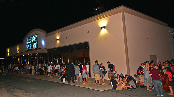 Salisbury: The line for the final Harry Potter film stretched around the building at Visonmax Cinema in Salisbury Thursday evening. Crowds began arriving around 8pm for the midnight showing. Photo by Ben Laing/Staff Photo
