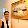 "Newburyport: Elena Ruocco Bachrach, executive director of the Newburyport Art Association, stands with a work in the association's latest exhibition, ""Art and Words"". Photo by Ben Laing/Staff Photo"