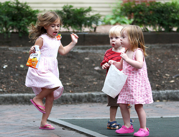 Newburyport: Bridgette Mellet, 5, left, hops around the Tot Lot on Inn Street in Newburyport Monday afternoon with her sister, Kate, 2, and Brody Kelly, also 2. Photo by Ben Laing/Staff Photo