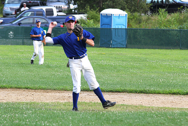 Rowley: Anthony Conte, shortstop for the Rowley Rams, fires a ball to first base during Wednesday afternoon's game against Ipswich. Photo by Ben Laing/Staff Photo