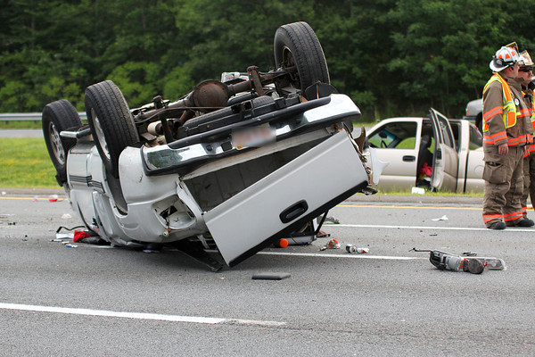 Byfield: A white pickup truck rolled over on Rt. 95, near Exit 55 in Byfield Wednesday afternoon. One of the passengers was taken by helicopter to a Boston hospital, as the northbound lane of the highway was closed to traffic. Photo by Ben Laing/Staff Photo