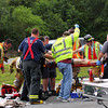 Newburyport: The victim of a roll over on Rt. 95 in Byfield is atteneded to by bystanders, EMT's and firefighters Wednesday evening near Exit 55. A Medflight was called in to fly him to a Boston hospital after officials closed the northbound lane of the highway. Photo by Ben Laing/Staff Photo