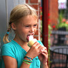 Newburyport: Carey Ritter, 7, of Newburyport, cools down Monday afternoon with an ice cream at Gram's on State Street. Photo by Ben Laing/Staff Photo