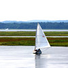 Newburyport: A sailboat glides along the water on the Plum Island River Tuesday afternoon. Despite the heat and humidity, a steady breeze made it a perfect day for boating. Photo by Ben Laing/Staff Photo