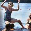Amesbury: Hannah Phipps, 11, gets flipped by friends while playing at a sunny Lake Gardner Beach on Thursday afternoon. The sun stays out for the weekend with continued dry weather, but getting muggier on Sunday afternoon. Bryan Eaton/Staff Photo
