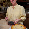 Groveland: Debra Stewart readies to top her Wild Maine Blueberry Pie Cheesecake. Bryan Eaton/Staff Photo
