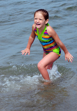 Salisbury: Brooke LaPointe, 5, of Andover splashes in the cool water of the Atlantic Ocean at Salisbury Beach State Reservation on Thursday afternoon. The weather continues in the 90's today with some slight cooling and drying for the weekend. Bryan Eaton/Staff Photo