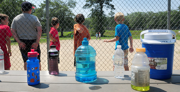 Amesbury: Plenty of quenching liquids were in quick reach for children playing dodgeball at the Amesbury Recreation Department's Summer Camp at the town park yesterday. Bryan Eaton/Staff Photo