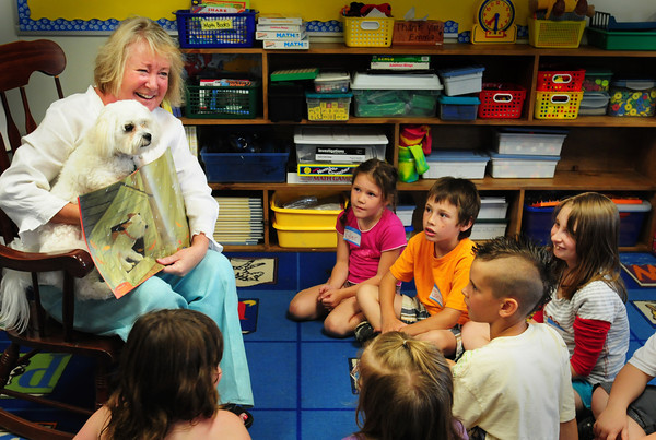 Newburyport: Assistant school superintendent for Newburyport Deidre Farrell introduces her pooch Baxter to students at the Bresnahan School yesterday morning. She was there for the summer program to read a couple stories about dogs before some students did some reading of their own to each other. Bryan Eaton/Staff Photo