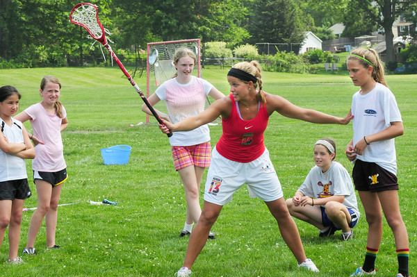 Newburyport: Acacia Walker instructs students of her lacrosse camp at the Nock Middle School. Bryan Eaton/Staff Photo