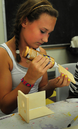Salisbury: Taylor Paquette, 15, glues together pieces of a birdhouse on Tuesday afternoon. She was in the arts room at the Boys and Girls Club in Salisbury. Bryan Eaton/Staff Photo