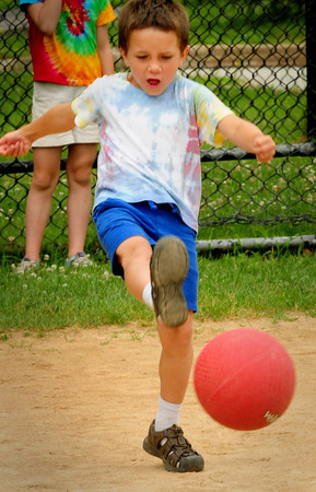 Amesbury: Korbin Walsh, 6, made it to first base on this hit in a game of kickball yesterday morning. He was at the Amesbury Recreation Department's Summer Camp which was held at the middle school, instead of the town park, in case of rain. Bryan Eaton/Staff Photo
