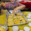 Newburyport: Chrysanthe Machiros of Newburyport takes Kataifi, a Greek pastry of filo dough, nuts and honey, out the baking pan and into small cups for the Greek Festival. Bryan Eaton/Staff Photo