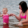 Amesbury: One year-old Shaylin Bilodeau of Amesbury, reacts as her mom Cassandra Donovan splashed the water. They wear at Lake Gardner Beach on Wednesday afternoon. Bryan Eaton/Staff Photo