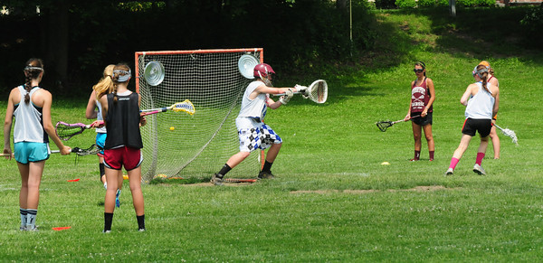Newburyport: Teens go through drills at the Nock Middle School at the Acacia Lacrosse Academy. Bryan Eaton/Staff Photo