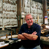 Amesbury: With dozens of flatware templates hanging behind, silversmith Bob Lapham reflects on his 48 years with Ould Newbury Crafters. Bryan Eaton/Staff Photo