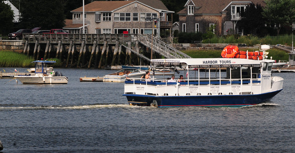 Newburyport: The Yankee Clipper Harbor Tours boat glides past the Salisbury Town Pier on Ring's Island in a view from the Newburyport waterfront. The weekend is looking good for outdoor activities and those on the water. Bryan Eaton/Staff Photo