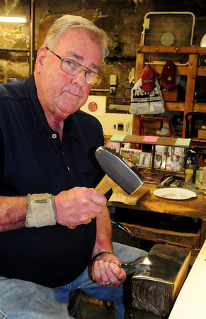 Amesbury: Bob Lapham is retiring after 48 years as a silversmith at Ould Newbury Crafters. Bryan Eaton/Staff Photo