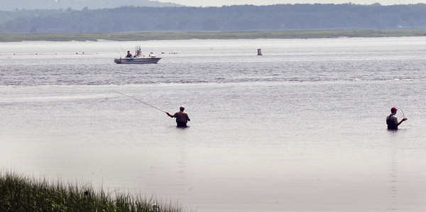 Salisbury: One place where it was cooler yesterdat was on the Merrimack River where these fisherman were near Ben Butler's Toothpick navigational marker at Salisbury Beach State Reservation. Bryan Eaton/Staff Photo