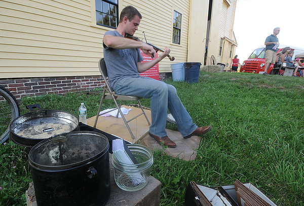 Newbury: Nick Bogosian of Houston TX plays the fiddle at the Summer Beer, Barbeque, and Baseball Dinner fundraiser at the Spencer Pierce Little farm in Newbury saturday night. Jim Vaiknoras/Staff photo