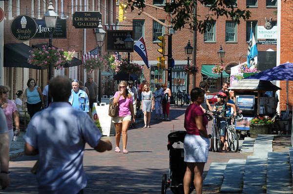 newburyport: Visitors to Newburyport enjoy a much cooler afternoon stroll down Inn Street Sunday. Jim Vaiknoras/Staff photo