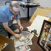 Amesbury: Barry Doucette a long time actor with the Valley Players who perform at the Amesbury Playhouse removes and packs theater masks in Bill Brooks office at the playhouse. Jim Vaiknoras/Staff photo
