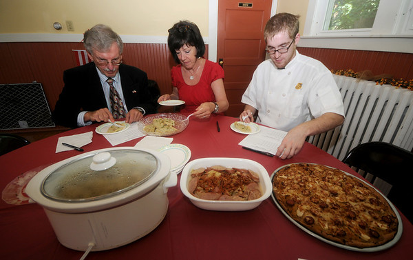 "Amesbury: Judges Merek Lesniewski-Lass, Meg Costello, and Ryan Chouinard sample the dishes at the ""Kielbasa Challenge"" at the Polish Club Saturday. The event was part of the Amesbury Days Celebration. Jim Vaiknoras/Staff photo"