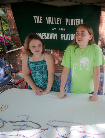 Amesbury: Actors Hannah Manclark , 10, and Lauren Legault , 11, help raise money for the theater group The Valley Players, by selling hand made bracelets at Amesbury Days Saturday. Jim Vaiknoras/Staff photo