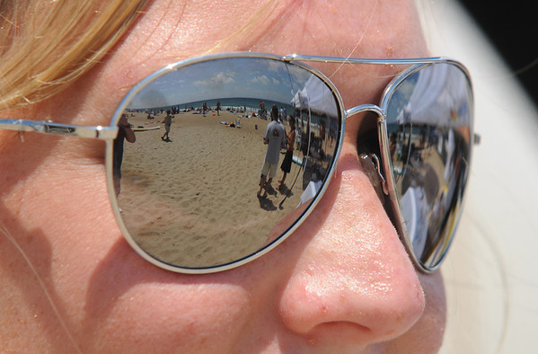 Salisbury: Iris Wilbur-Kamien of Windham NH checks out the action at the Surf Music and Art Fest at the beach. jim Vaiknoras/Staff photo