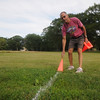 newburyport: Don Hennigar  puts out cones at the finish line before the weekly cross country race at Maudslay State Park in Newburyport. JIm Vaiknoras/Staff photo