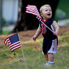 Amesbury: Thomas Puorro, 1,  gets excited as he waves the flag at annual Pancakes Under the Pines in Amesbury Monday morning. Jim Vaiknoras/Staff photo