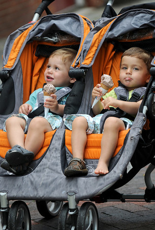 Newburyport: Twin brothers Baylen and Ian Fuselier, 21 months enjoys ice cream cones on Inn Street Sunday afternoon. The pair are from Cambridge and are staying in Newburyport for teh weekend. Jim Vaiknoras/Staff photo