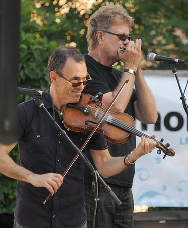 Amesbury: EJ Ouellette and Scott Billington perform with EJ & Crazy Maggy at the Al Capp Amphitheater at the Mill Yard in Amesbury. Jim Vaiknoras/Staff photo