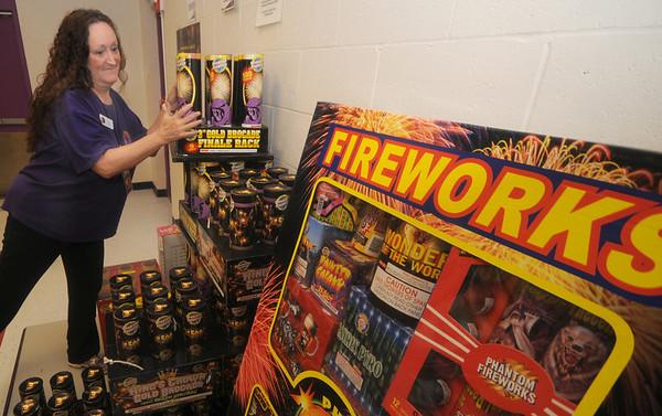 Seabrook:April Walton of Phantom Fireworks stock shelves at their Seabook New Hampshire store. Jim Vaiknoras/Staff photo