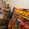 Seabrook:April Walton of Phantom Fireworks stock shelves at their Seabook New Hampshire store. Jim Vaiknoras/Staff photo